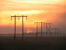 Fog sun + electrification. Electric columns small big where they only are not present. All time strive to get in the staff closing itself and the wires stock image