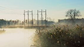 Fog with sun light at frosty morning river. Fog with sun light at frosty morning on the river stock video footage