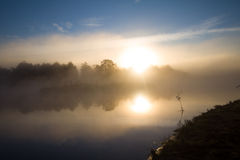 Fog and sun  on the river Stock Photo