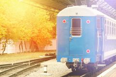 Fog and sun shine retro railway train station. Vintage color style. Concept of nostalgia. Fog and sun shine on the retro railway train station. Vintage color Stock Photos