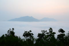 Fog and sunrise on the Moutain Stock Images