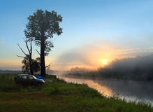 Fog sunrise on the river. With camping Royalty Free Stock Photo