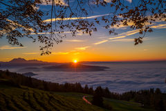Fog surrounding town Zug and Zugersee during the sunset. With the Pilatus and Swiss Alps in the background royalty free stock photos