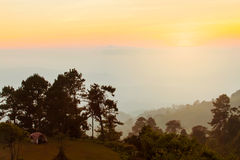 Fog and suunrise at mountain, landscape background, Thailand Stock Photography
