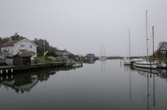 Fog on the swedish westcoast. The boat is in the harbour Royalty Free Stock Photos