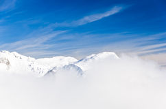 Fog at the top of the mountain on a winter sunny morning Royalty Free Stock Images
