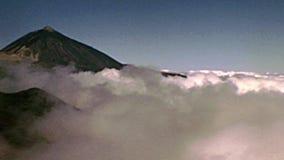 Tenerife island Teide fog. Fog on the top peak of the Teide Volcano mountain in Teide National Park. Historical archival of Tenerife island of Spain in Africa in stock video footage