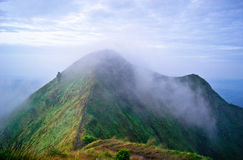Fog on the top. Sunrise in the mountains in Indonesia Stock Photo
