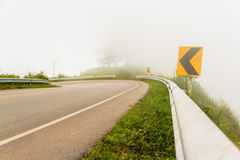Fog and traffic signs Royalty Free Stock Image