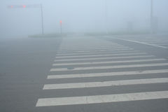 Fog-Urban Intersection. The Morning Fog-Urban Intersection Stock Photos