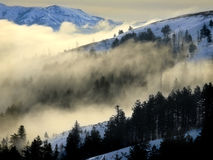 Fog in a Valley with Mountains Stock Photos