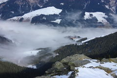 Fog in a valley. Fog in a snowy valley Royalty Free Stock Photography