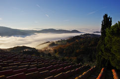 Fog in the valleys near Florence at sunrise. Royalty Free Stock Photos