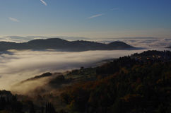 Fog in the valleys near Florence at sunrise. Stock Photo
