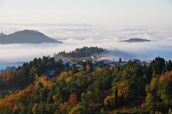 Fog in the valleys near Florence at sunrise. Stock Photos