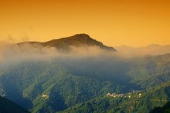Fog and village   in corsica island Stock Photo