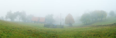 Fog in the village Stock Image