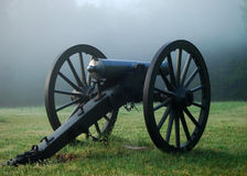 Fog of War. An American Civil War cannon sits quietly as fog rises on the battlefield early in the morning at Shiloh National Military Park Stock Images