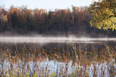Fog on the water in fall Stock Photo