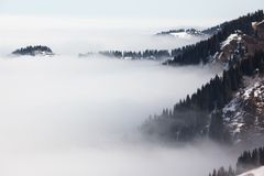 Fog in winter mountains Royalty Free Stock Image