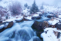 Fog in winter mountains Stock Photo