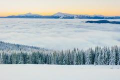 Fog in winter mountains. Fantastic sunset. Carpathians. Ukraine. Stock Images
