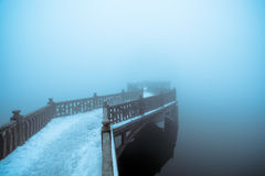 Fog and zigzag bridge Stock Images