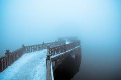 Fog and zigzag bridge. Winter fog and zigzag bridge on the lake stock images