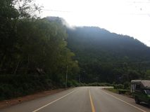 Foggy mountain tops and road trips. royalty free stock photography