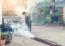Fogging to eliminate mosquito and zika virus. Man work fogging to eliminate mosquito for preventing spread dengue fever and zika virus royalty free stock images
