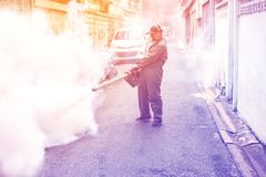 Fogging to eliminate mosquito and zika virus. Man work fogging to eliminate mosquito for preventing spread dengue fever and zika virus stock image