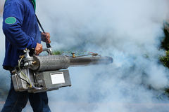 Fogging to prevent the dengue fever Royalty Free Stock Image
