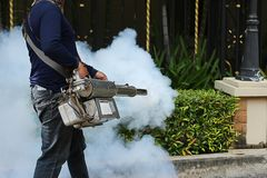 Fogging to prevent the dengue fever Stock Photography
