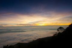 Foggy above mountain at morning sunset timing. In a scene of landscape view location at north of Thailand stock photos