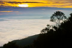 Foggy above mountain at morning sunset timing. In a scene of landscape view location at north of Thailand stock images