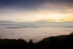 Foggy above mountain at morning sunset timing. In a scene of landscape view location at north of Thailand stock image