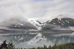 Foggy Alaska landscape lake, mountains and forest Stock Photo