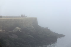 Foggy anglers Stock Photography
