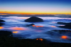 Foggy Aramaio valley at night with Muru peak Stock Image