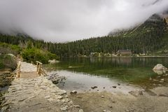 Foggy autumn landscape at the Popradske Pleso lake. High Tatras. Royalty Free Stock Photo