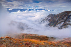 Foggy autumn morning in the Caucasus mountain. Stock Photos