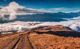 Foggy autumn morning in the Caucasus mountain. Stock Photos