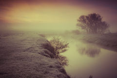 Foggy autumn morning on the river. Royalty Free Stock Photo