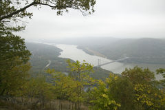 Foggy autumn view overlook of Bear Mountain Bridge and Hudson Valley and River at Bear Mountain State Park, New York Royalty Free Stock Photo
