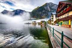 Free Foggy Autumnal Sunrise At Famous Hallstatt Lakeside Town Reflect Royalty Free Stock Images - 127842199