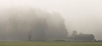 Foggy Barn in Cades Cove Stock Photography