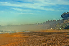 Foggy beach. Scenic view of foggy beach with blue sky and cloudscape background, Santa Cruz, California, U.S.A Stock Photography