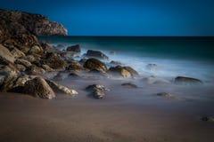 Foggy beach Stock Images