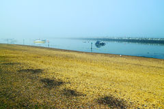 Foggy beach seashore landscape Royalty Free Stock Images