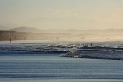 Sunny bech in the haze. Foggy beach in sunset time in Cantabria, Spain Stock Photography